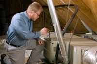 Technician performing furnace repair in Asbury, NJ.